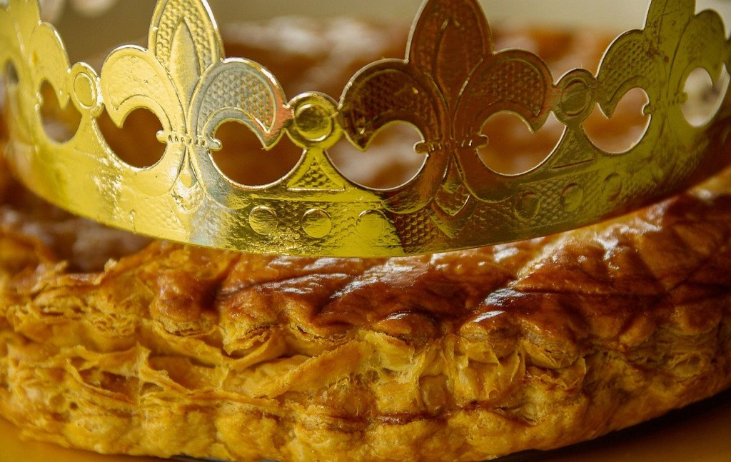 A galette des rois with a golden crown resting on top