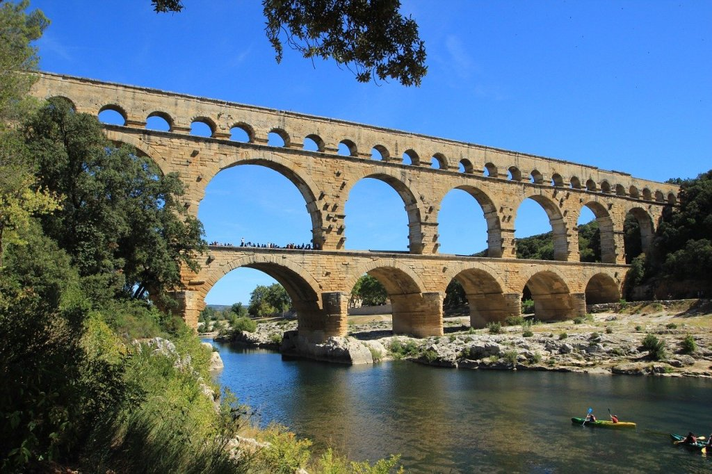 Pont du Gard with canoeists passing under it