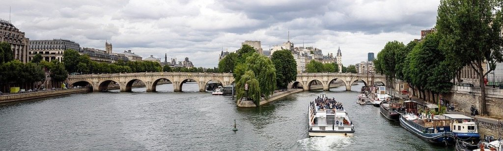A panoramic view of the Pont Neuf spanning the Seine in Paris