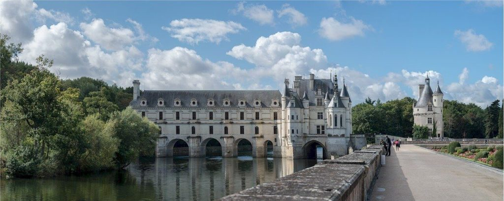 The Château de Chenonceau. This photograph shows the main building, the gallery spanning the River Cher, and the keep.